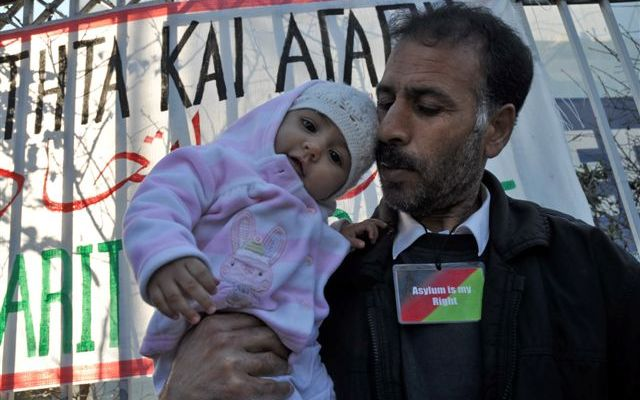 Reza and his daughter outside the ministry of citizen protection in Athens