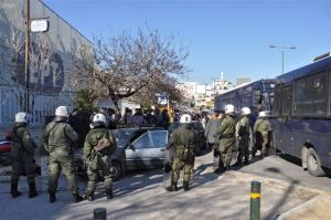 riot police surround afghan men on way to greek ministry of citizen protection