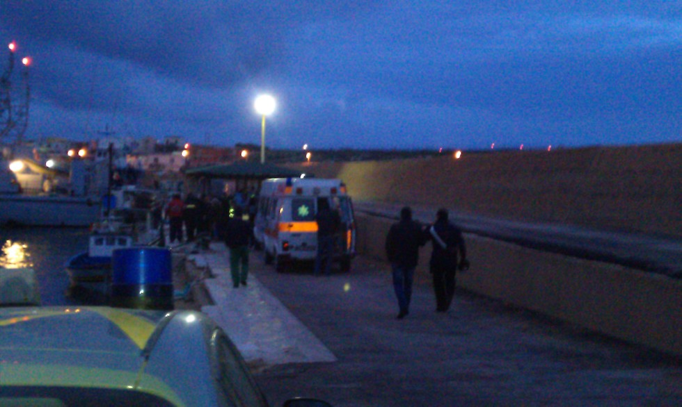 Tunisians being treated by Italian coast guards