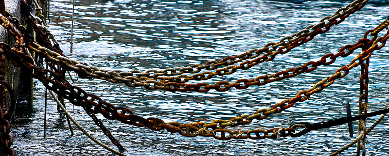 heavy chains hanging across water